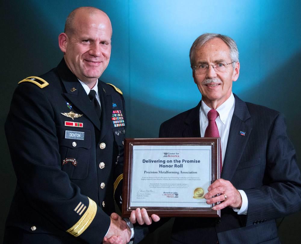 Brigadier General Ivan Denton presents the CFA Award to Bill Gaskin, President, Precision Metalforming Association