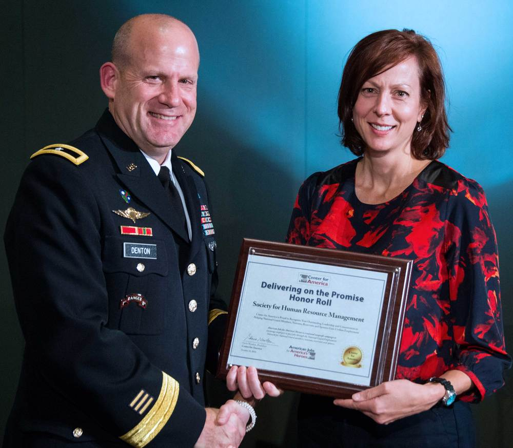 Brigadier General Ivan Denton presents the CFA Award to Nancy Hammer, Senior Government Policy Counsel, Society for Human Resource Management