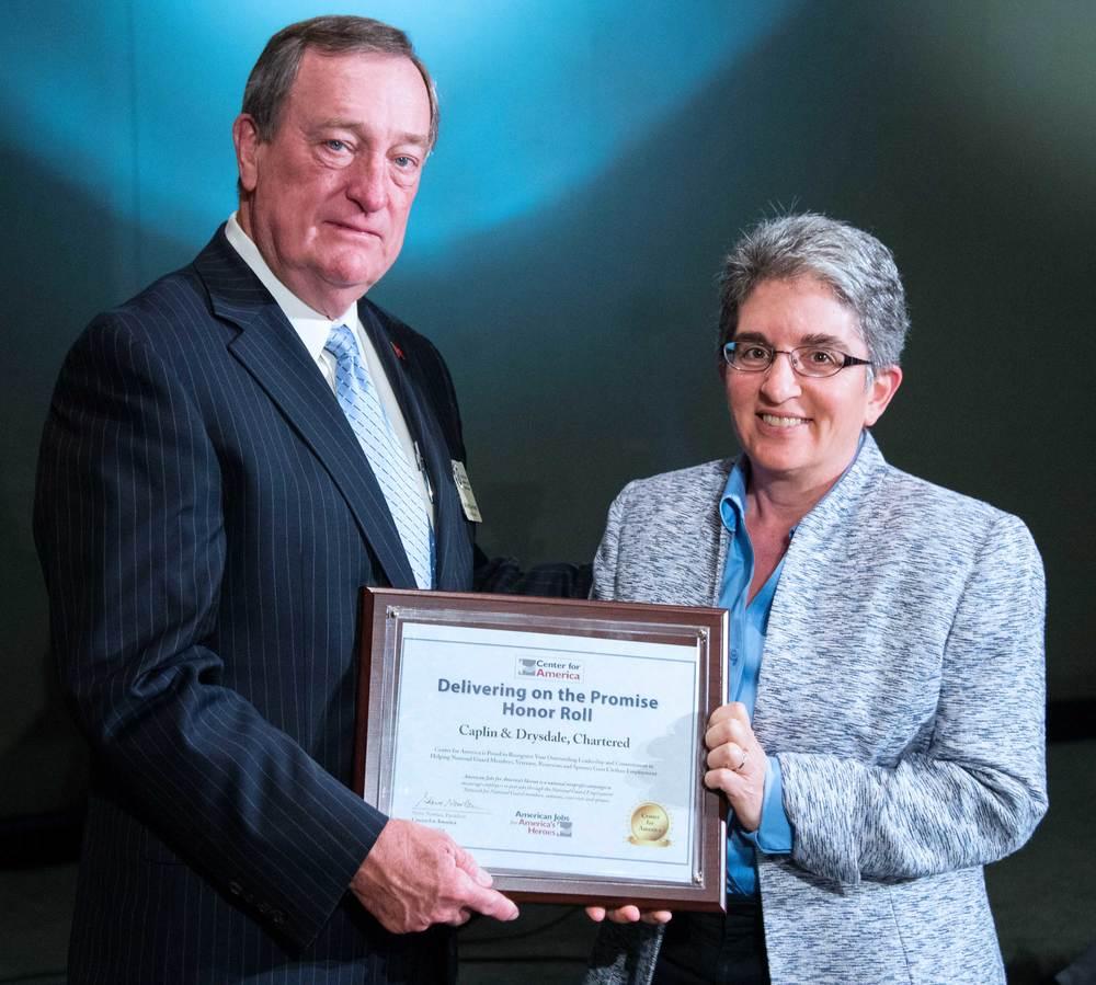 Major General (ret) Gus Hargett presents the CFA Award to Beth Shapiro Kaufman, Member, Caplin & Drysdale