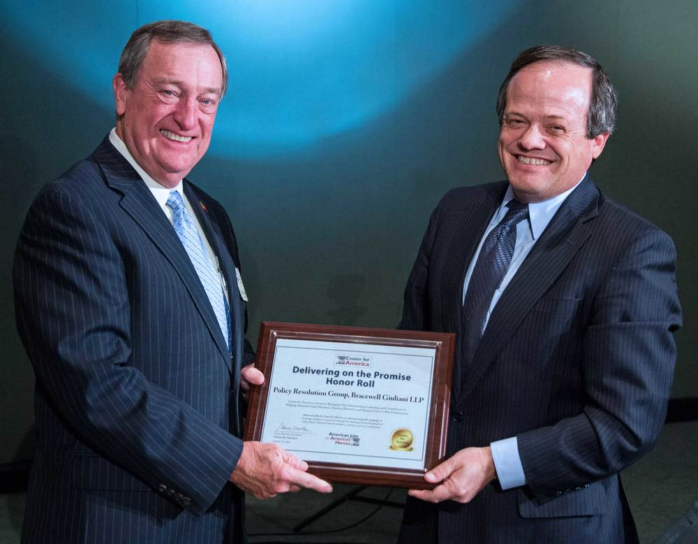 Major General (ret) Gus Hargett presents the CFA Award to Paul Nathanson, Policy Resolution Group, Bracewell & Giuliani, LLP