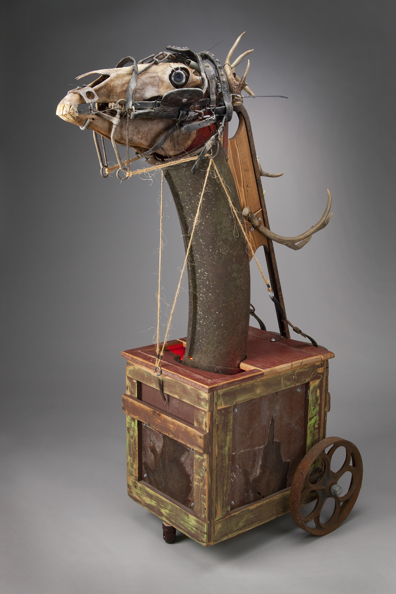 The Debt (We Can Never Repay) $3,000 wood, steel, leather, neon, horse skull, whitetail & mule deer antlers, buckboard springs, found objects 66 x 26 x 26