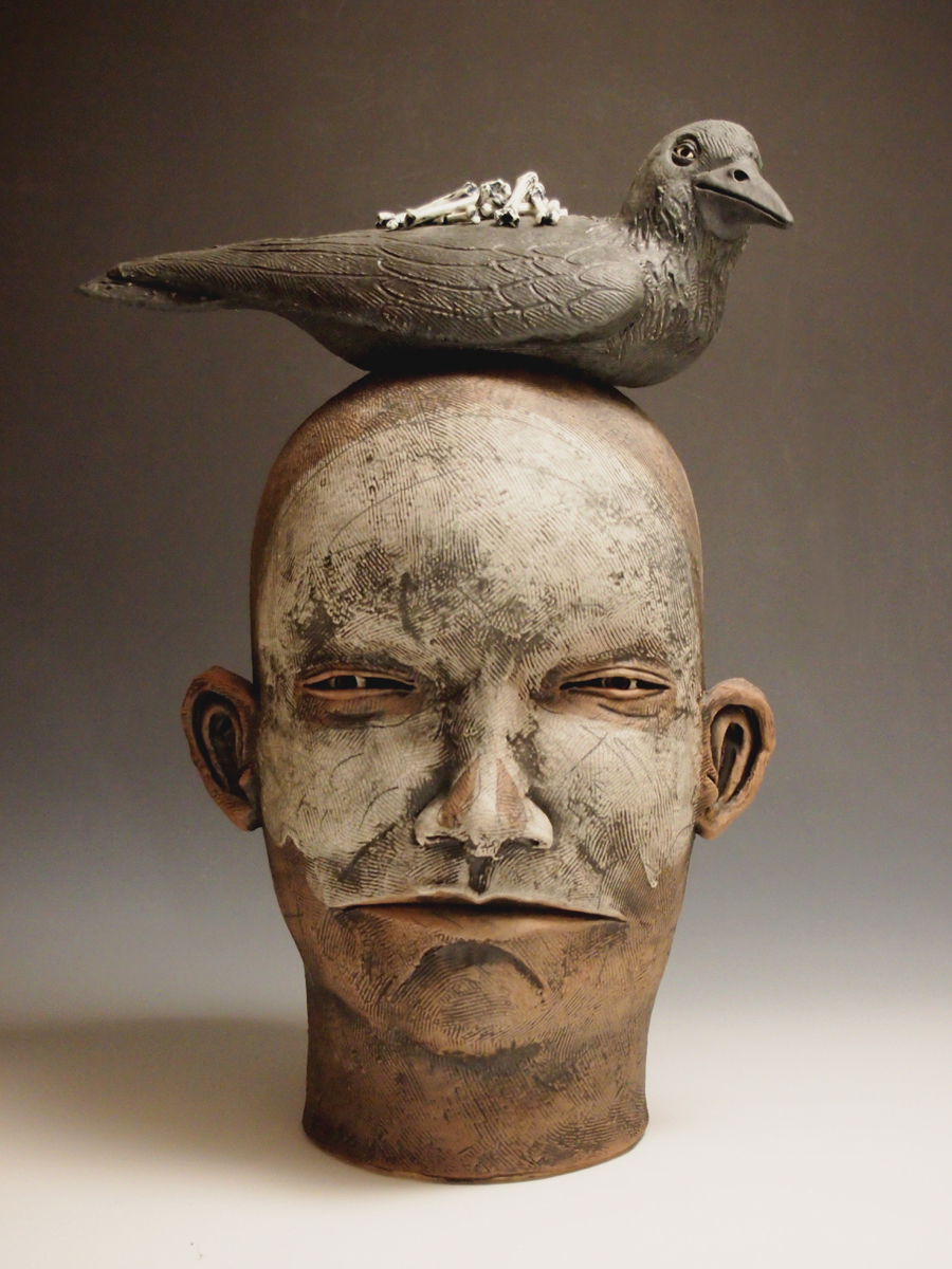 Head with Crow and Bones