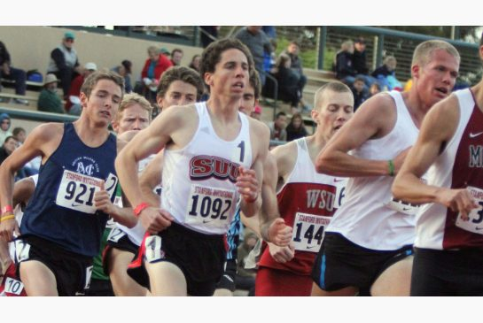 Canadian runner Cam Levins, centre, seen in this file photo, posted a world-leading time for this season in his Armory Track Invitational race on Saturday night. The Canadian Press
