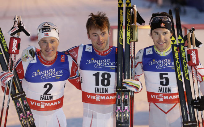 Norway's Petter Northug, center, and Ola Vigen Hattestad, left, along with Canada's Alex Harvey celebrate after the 1.4km cross-country final at the Nordic skiing world championships in Falun, Sweden, on Thursday, Feb. 19, 2015. (AP Photo/Matthias Schrader)