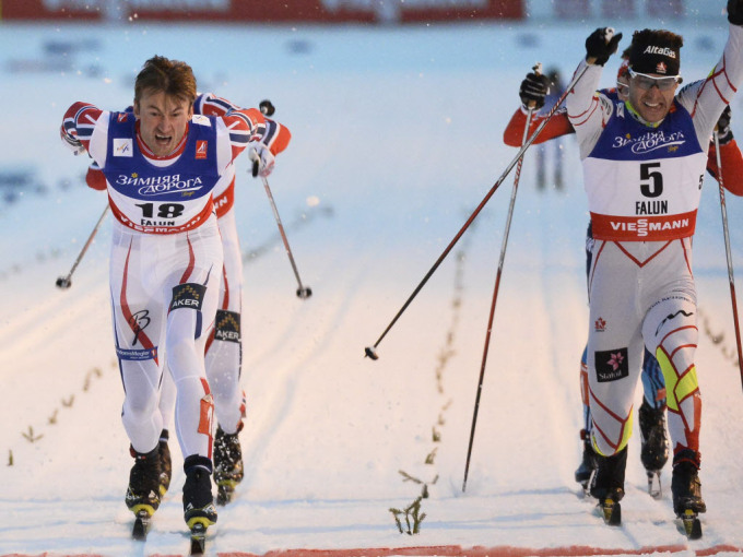 Norway's Petter Northug, left, crosses the finish line to edge Alex Harvey of Canada, right, during the men's sprint final at the Nordic skiing world championships in Falun, Sweden, on Thursday, Feb. 19, 2015. (AP Photo/Anders Wiklund, TT)