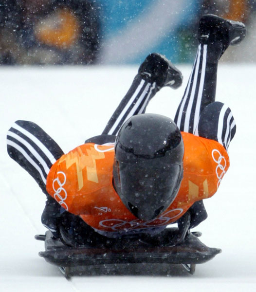 Canadian Men's skeleton rider Duff Gibson of Calgary jumps onto his sled during competition Wednesday Feb. 20, at the 2002 Olympic Winter Games in Salt Lake City. (CP Photo/COA/André Forget).