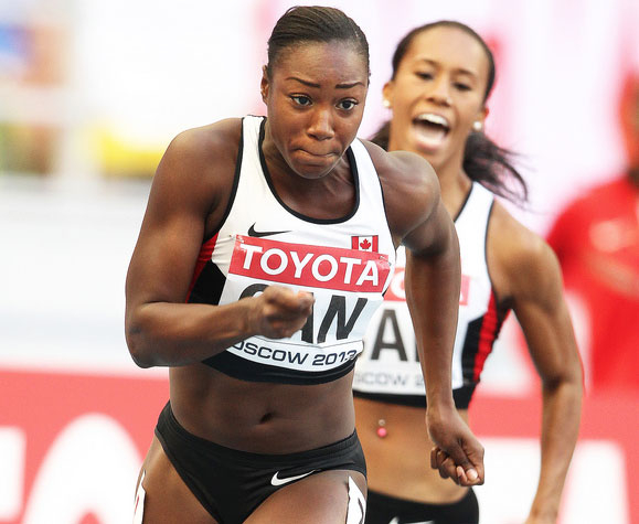 Khamica Bingham prepares to receive the baton in a relay. Photo via Athletics Canada.