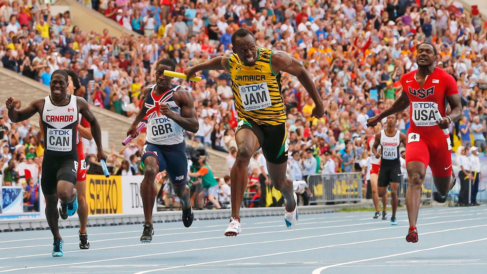 Justyn Warner (left of screen) runs the anchor leg that ultimately delivered Canada a bronze medal in the 2013 World Championships behind Usain Bolt-led Jamaica and the United States.