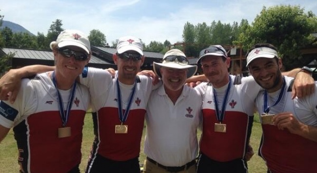 Photo: Braithwaite (second from right) with Canada's Men's Quad (M4x) and coach, Howie Campbell, at the 2014 World Rowing Cup II after winning bronze.