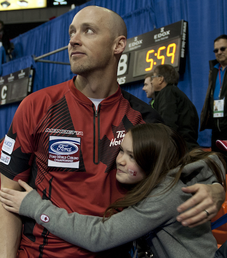 Canada's Nolan Thiessen gets a post-game hug from daughter Tyra after winning the bronze medal on Sunday. (Photo, Curling Canada/Michael Burns)
