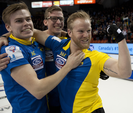 Niklas Edin, right, celebrates his Ford Worlds win with teammates Christoffer Sundgren, left, and Kristian Lindström. (Photo, Curling Canada/Michael Burns)