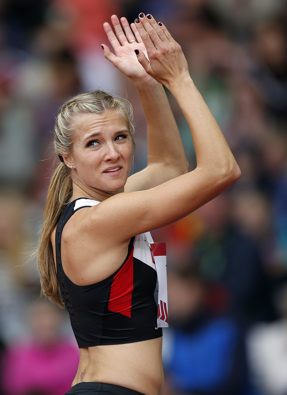 Canada's Brianne Theisen-Eaton applauds during the Women's Heptathlon jumping competition at Hampden Park Stadium during the Commonwealth Games 2014 in Glasgow, Scotland, Tuesday July 29, 2014. (AP Photo/Frank Augstein)