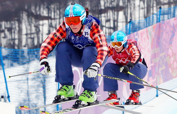Canada's Marielle Thompson leads compatriot Kelsey Serwa in the women's ski cross final at the Rosa Khutor Extreme Park, at the 2014 Winter Olympics. Photograph by: Sergei Grits , AP
