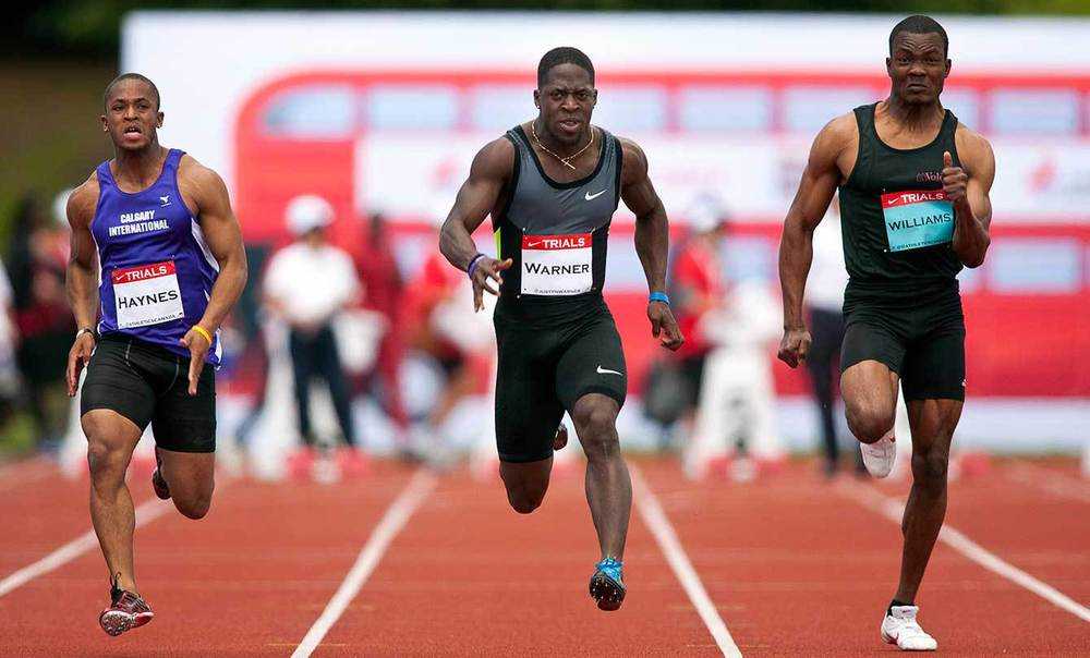 Olympians Akeem Haynes (left) and Justyn Warner (centre) run in the men's 100m at Canadian Track and Field Championships in Calgary, Alta., Friday, June 29, 2012.THE CANADIAN PRESS/Jeff McIntosh