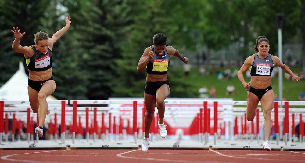 Heptathlete Jessica Zelinka, left, ended up winning the women's 100-metre hurdles championship racing against Perdita Felicien, middle, and Priscilla Lopes-Schliep at the Canadian Track and Field Championships in Calgary, Alta., Saturday, June 30, 2012.THE CANADIAN PRESS/Sean Kilpatrick