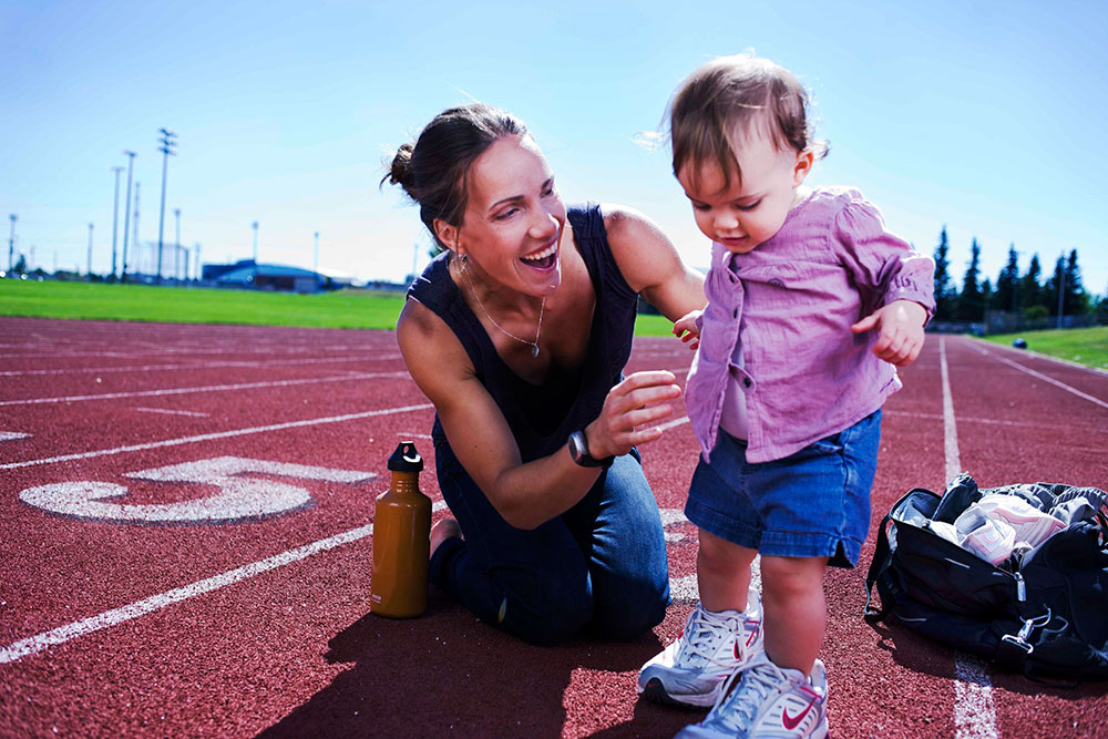 DAVE HOLLAND Canadian heptathlete Jessica Zelinka and her daughter Anika.