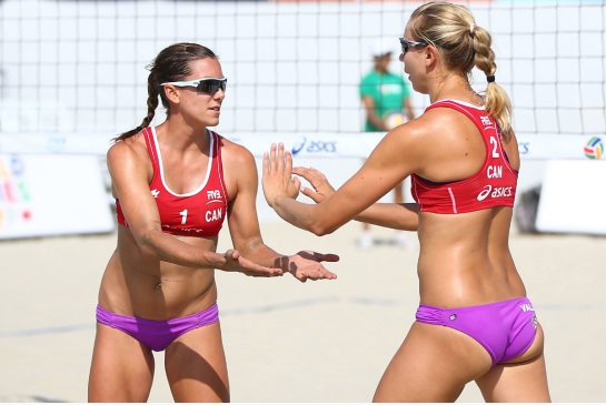 JOE SCARNICI / GETTY IMAGES Jamie Broder, left, and Kristina Valjas became the first Canadian women to win a world tour event in beach volleyball earlier this year.