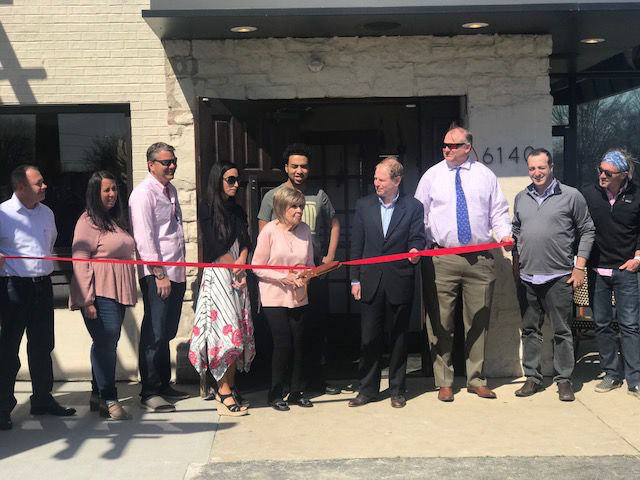 Solon Mayor Edward Kraus, center, with owner Bret Adams and his wife Michelle, third and forth left, and her family members along with city representatives at Rose Italian Kitchen's grand opening ribbon cutting ceremony.