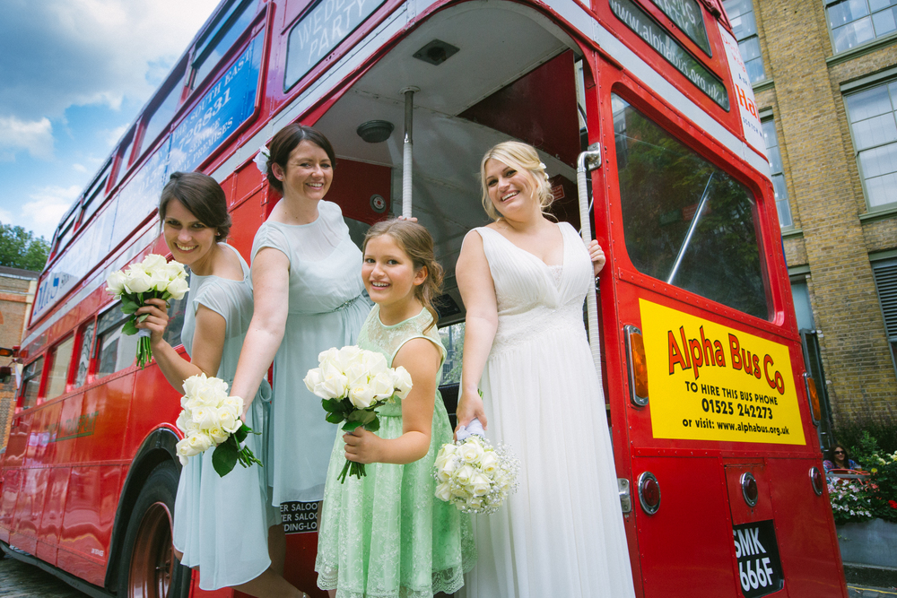 Wedding Photographer - Bride and bridesmaids waling off bus