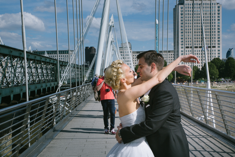 Newlyweds Kissing on Footbridge