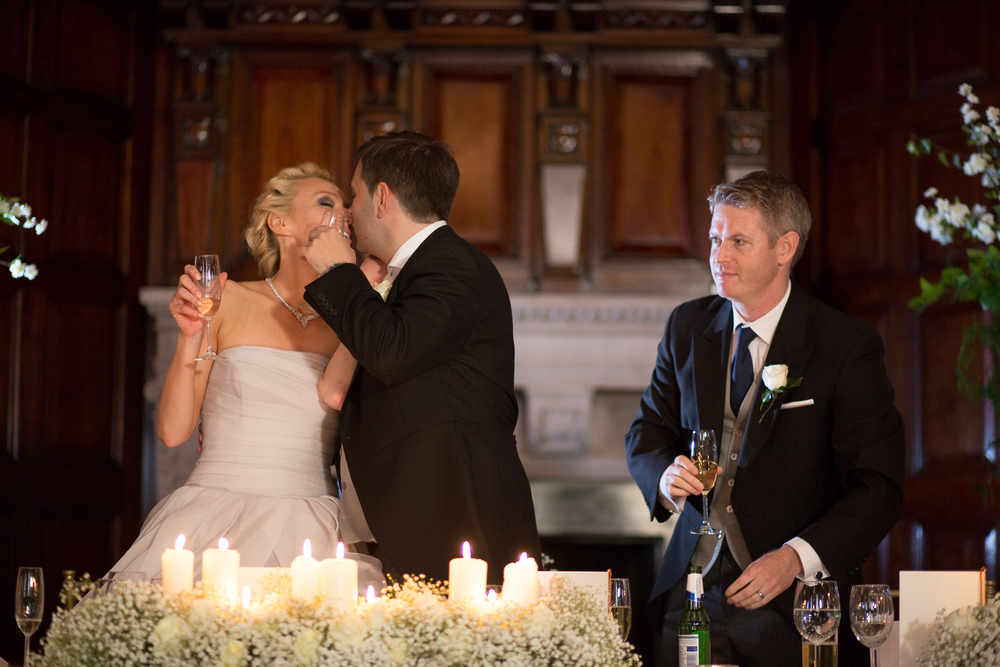 Wedding Couple Kissing with Glass Of Champagne