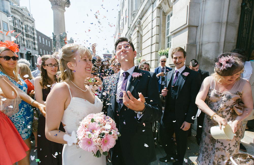 Wedding Photographer - Confetti falling on married couple
