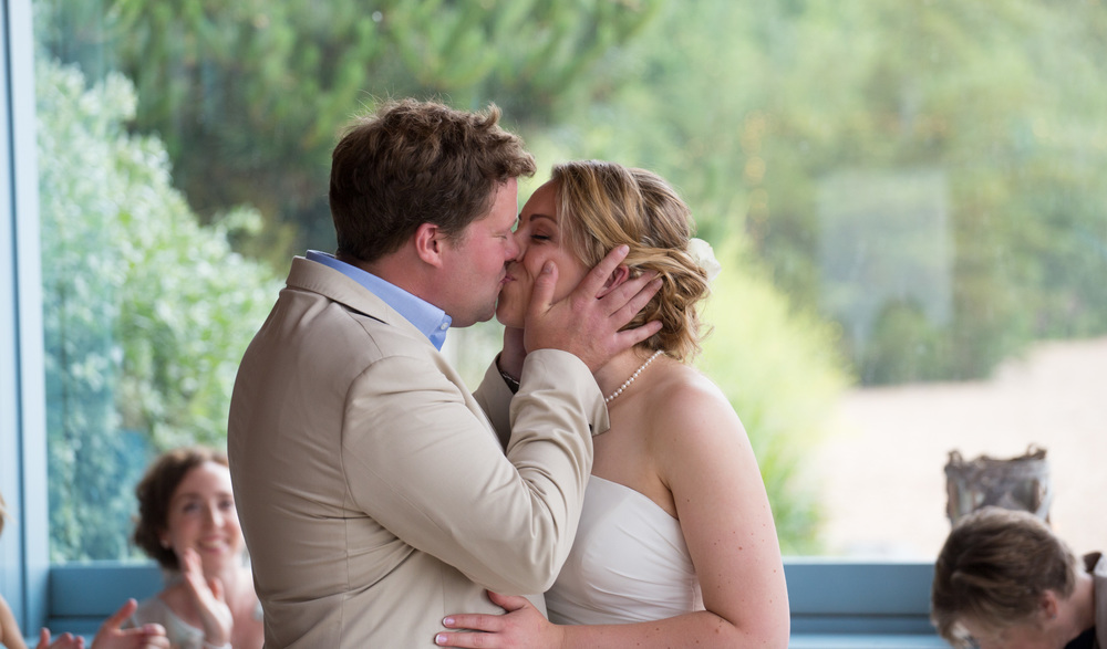 Wedding Couple In Passionate Kiss