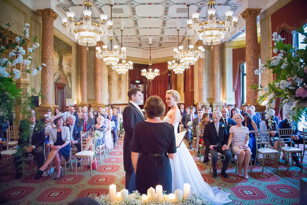 Wedding Shot of couple getting married in large hall