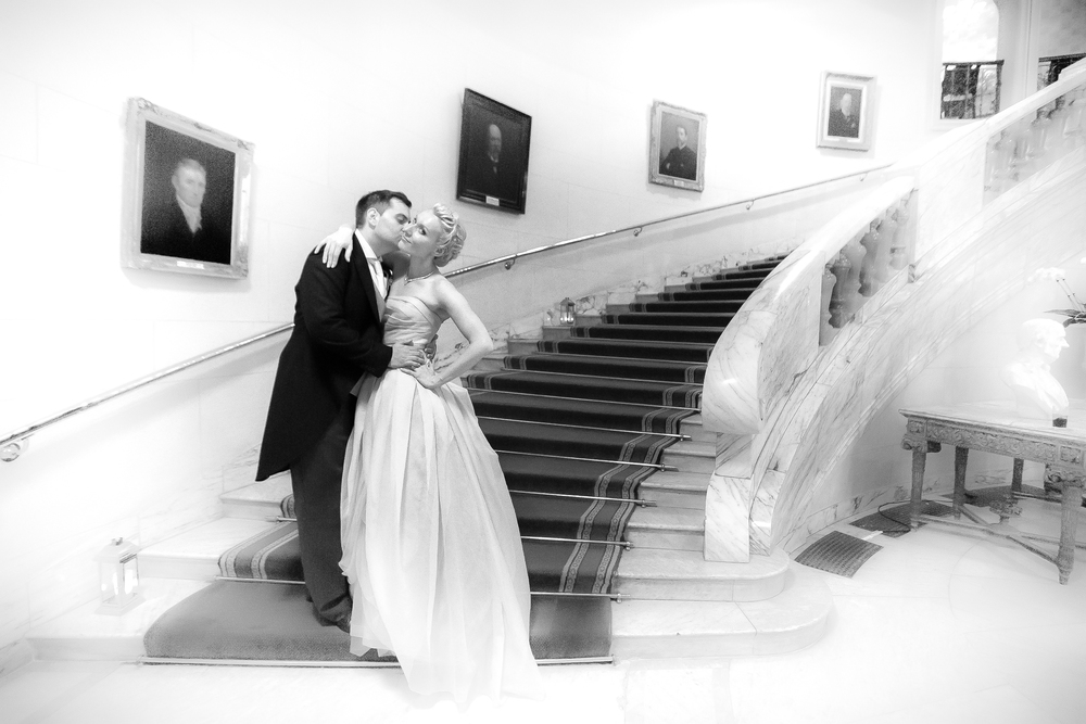 Wedding Photo of couple walking up stairs