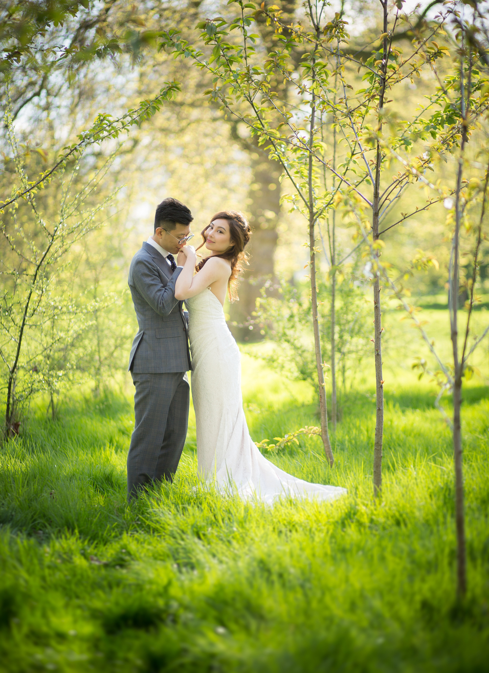 Asian Wedding Couple Standing In Woods