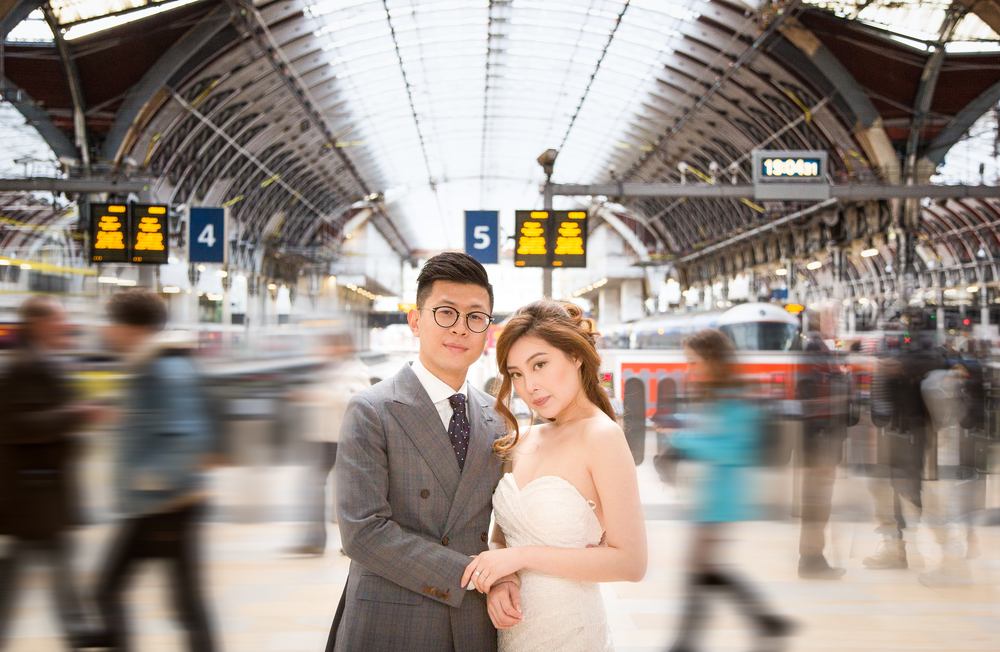 Young Newly-Wed Asian Couple in Train Station