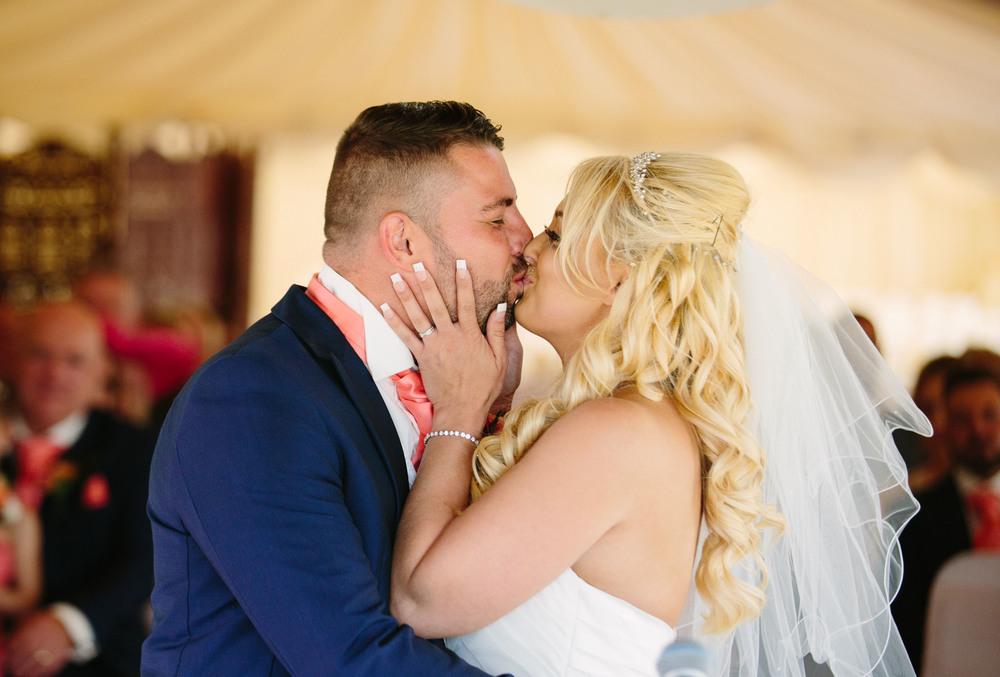 Essex-countryside-wedding-summer-first-kiss