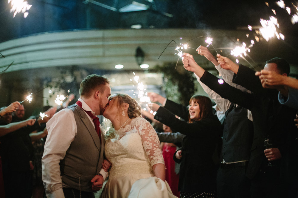 southdowns-manor-sussex-winter-wedding-photography-sparkler-arch-93