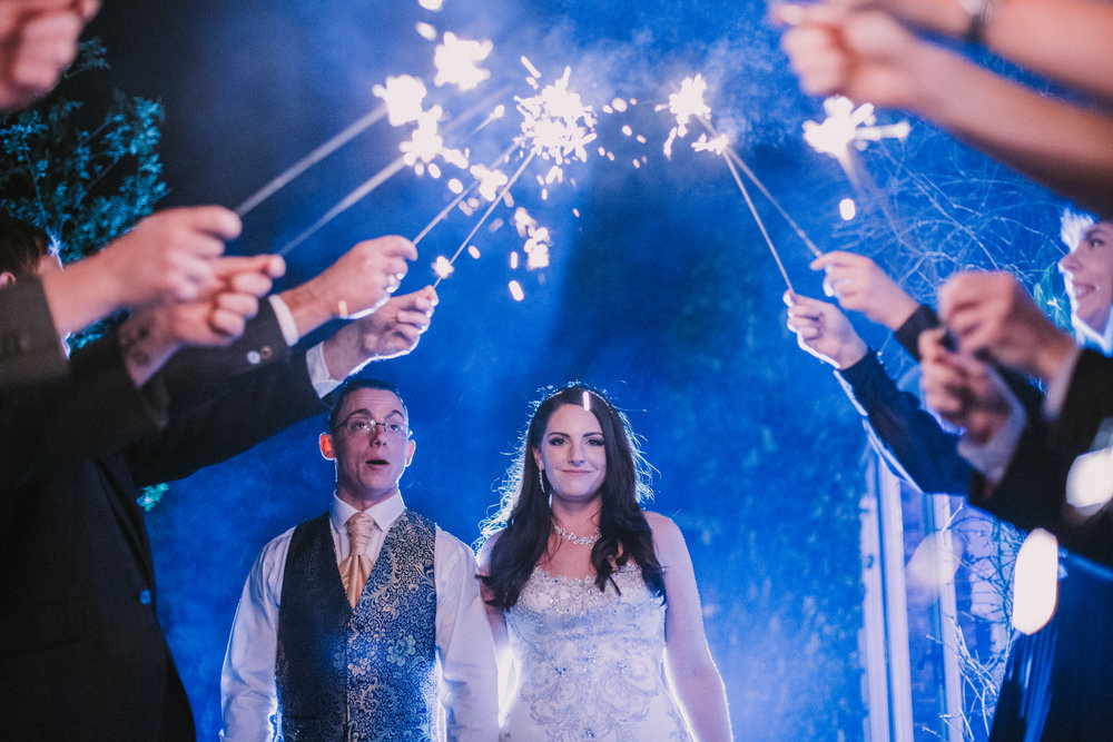 northbrook-park-hampshire-spring-winter-wedding-photographer-sparkler-arch-1