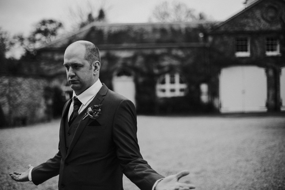 northbrook-park-farnham-hamnpshire-winter-spring-wedding-photography-best-man-black-and-white-36
