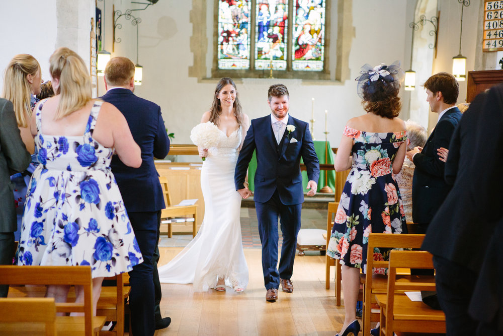 kent-wedding-photography-kingsnorth-church-bride-groom-aisle-01