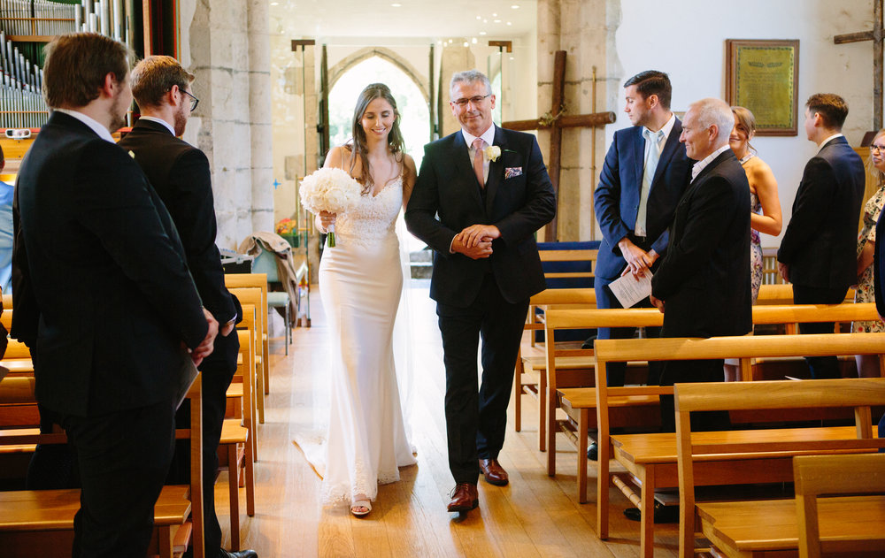 kent-wedding-photography-kingsnorth-bride-aisle-27