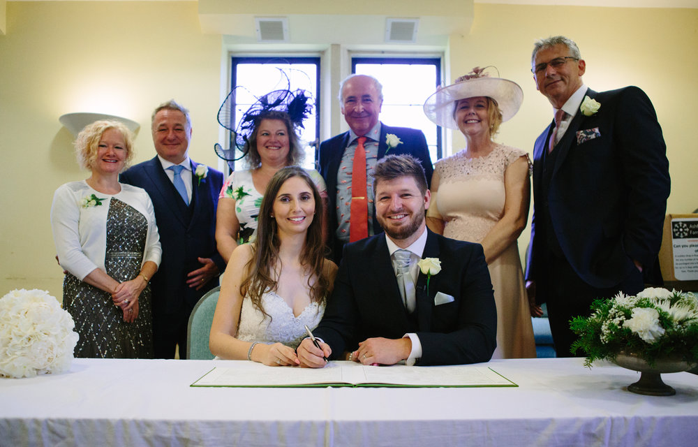 kent-wedding-photography-kingsnorth-signing-register-41