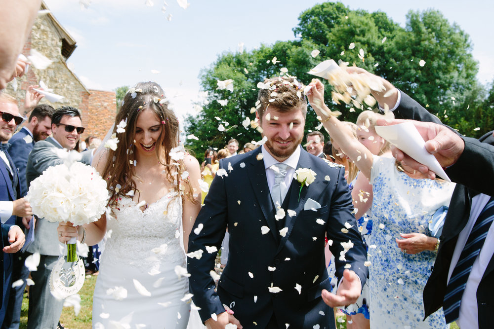 kent-wedding-photography-kingsnorth-church-confetti-44