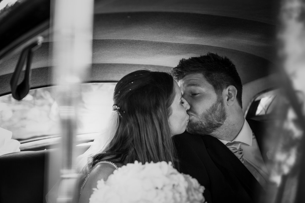 kent-wedding-photography-kingsnorth-car-kiss-just-married-51