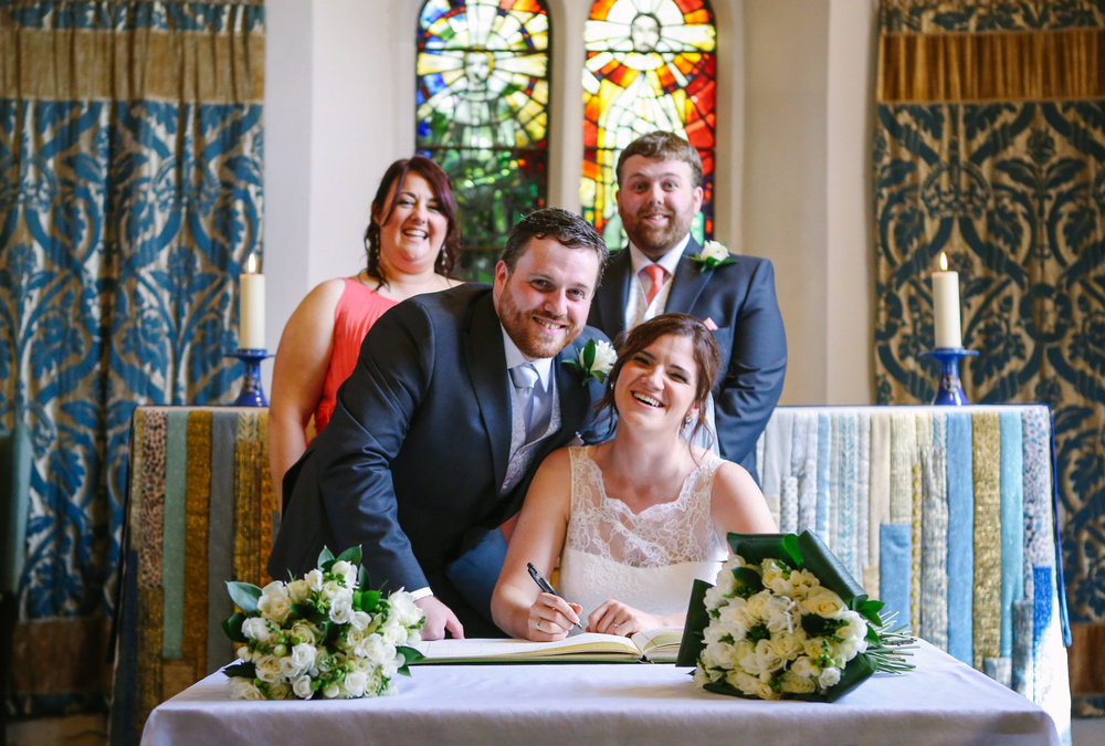 reigate-surrey-london-wedding-photography-signing-register-57