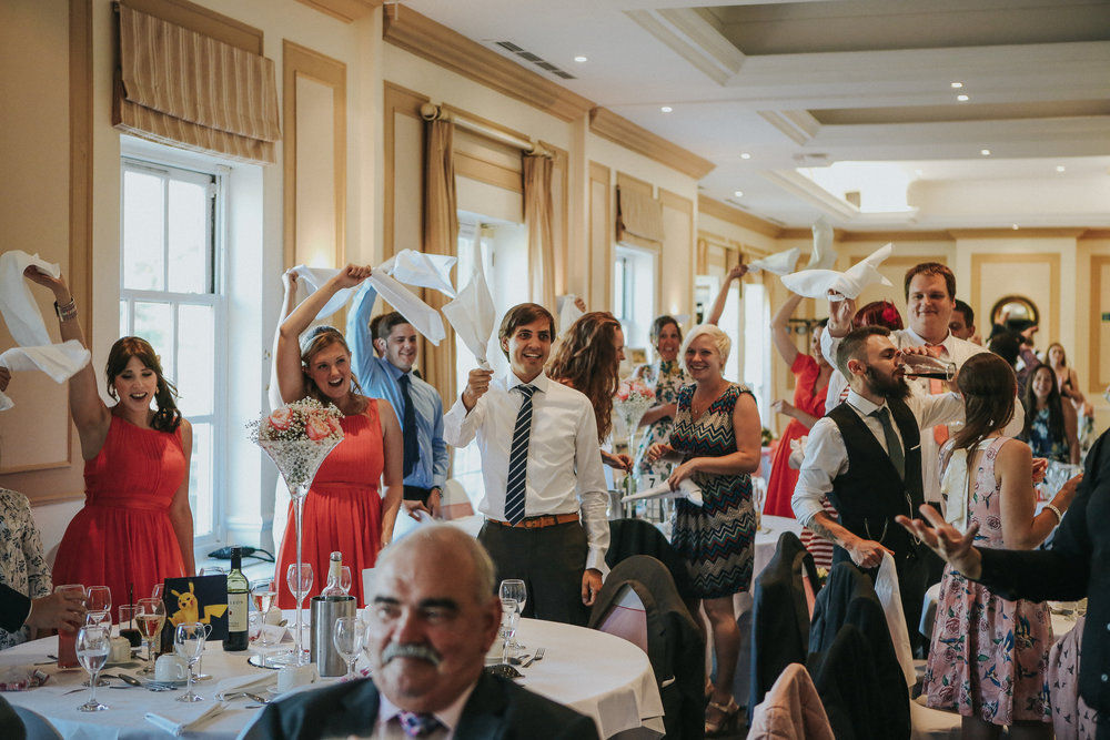 reigate-surrey-london-wedding-photography-group-formal-shot-reception-woldingham-golf-club-singing-waiters-97