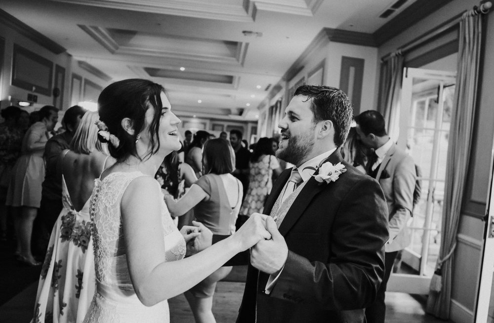 reigate-surrey-london-wedding-photography-group-formal-shot-reception-woldingham-golf-club-first-dance-111