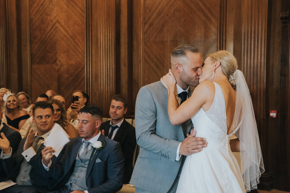 marylebone-old-town-hall-wedding-photography-videography-first-kiss-38