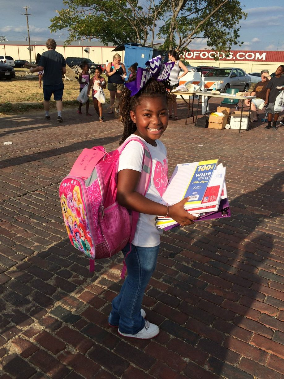 Ta'Niya shows off her brand new backpack.
