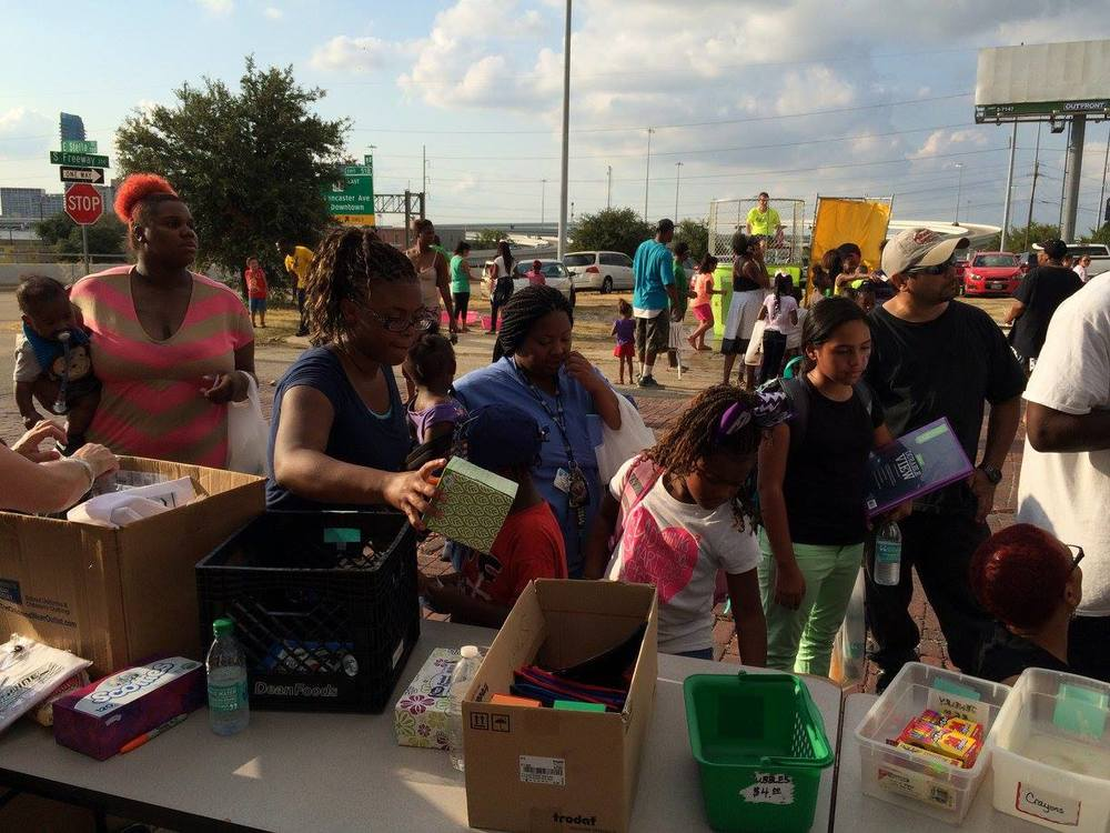 Families wait in line to cash in their points for new school supplies.