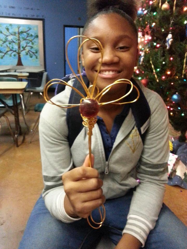 7th grader Arianna shows off her wire sculpture