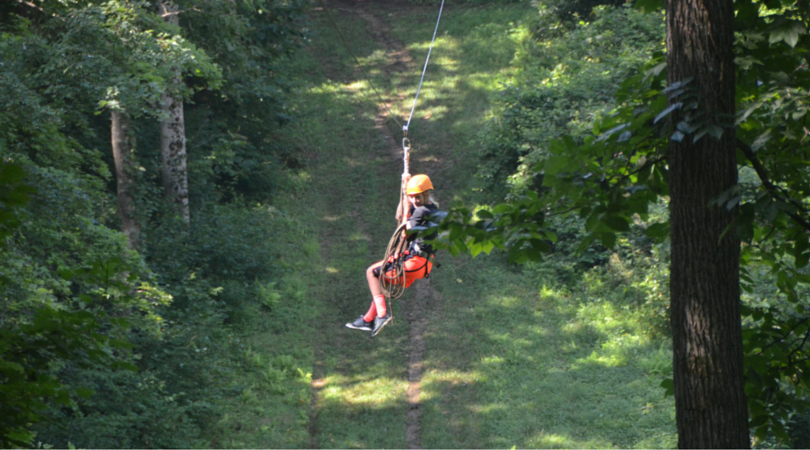 Zip lining across the woodlands of the swva 4-h center