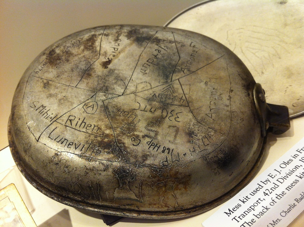 Mess kit used by E. J. Oles in France 1917-1918. The kit displays a map of france