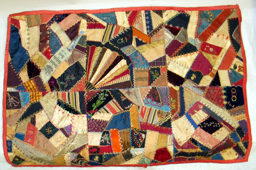 A baby crib Crazy Quilt that contains multicolored patchwork and needlepoint. It was made in Cleveland  in 1884 for Daniel Hendricks.